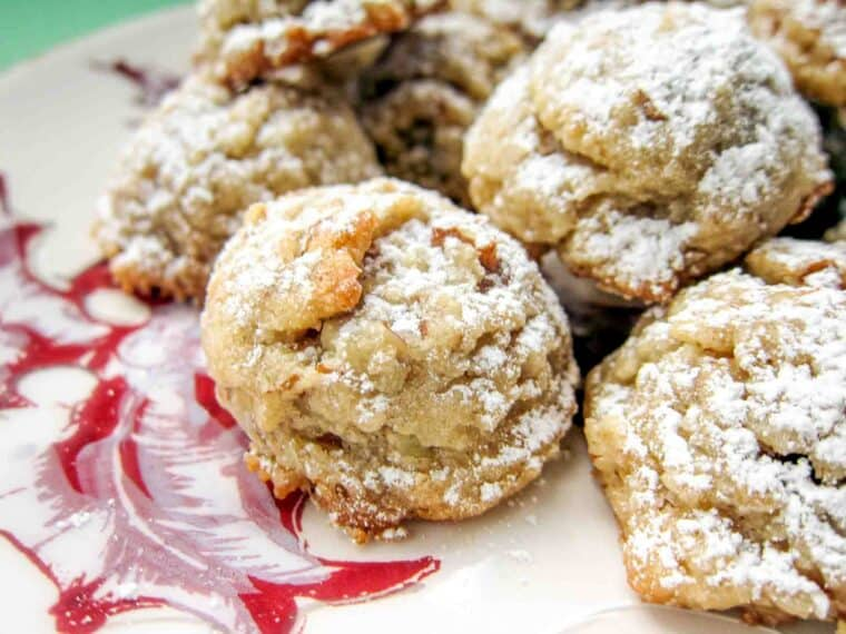 plate of pecan cookies dusted with powdered sugar