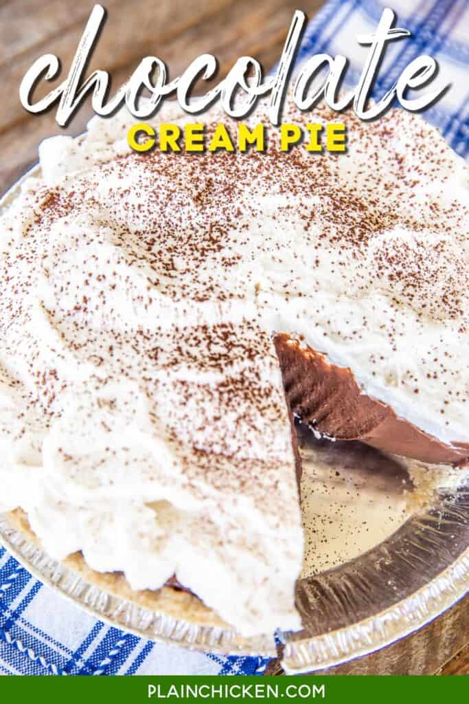 chocolate cream pie with whipped cream with a slice cut out
