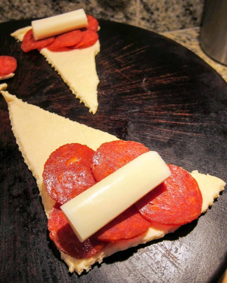 crescent roll topped with pepperoni and string cheese