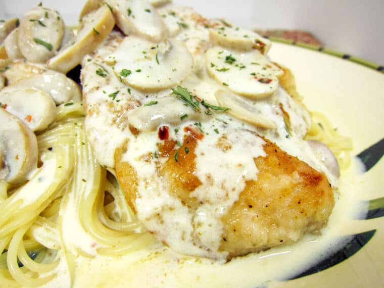 plate of chicken and pasta in cream sauce