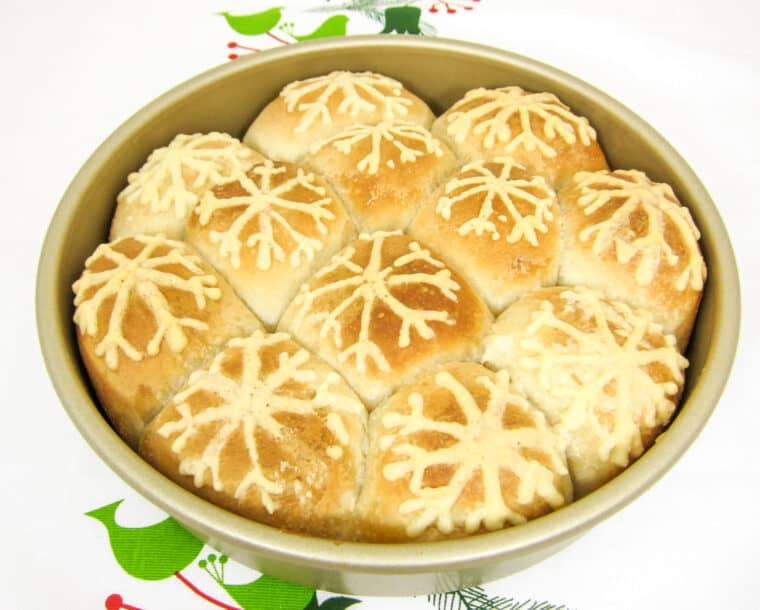 pan of rolls with a snowflake design on top