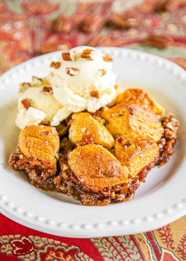 plate of biscuit pecan pie with ice cream