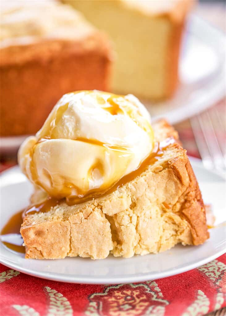 slice of pound cake topped with ice cream on a plate