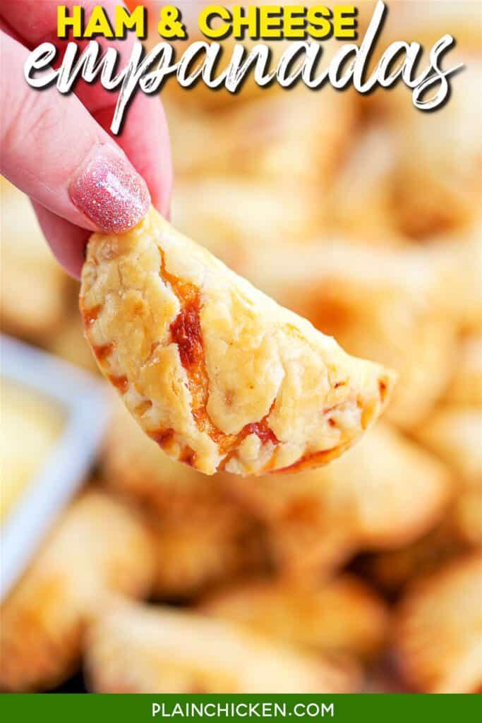 holding a ham & cheese empanada pie