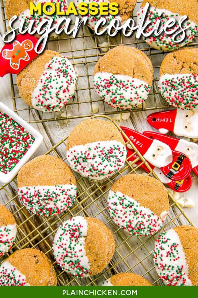 molasses sugar cookies dipped in white chocolate on a cooling rack