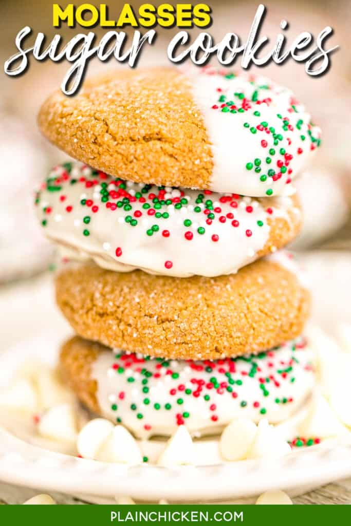 molasses sugar cookies dipped in white chocolate stacked on a plate
