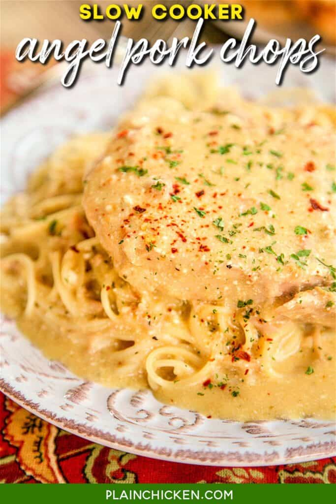 plate of pork chops over pasta