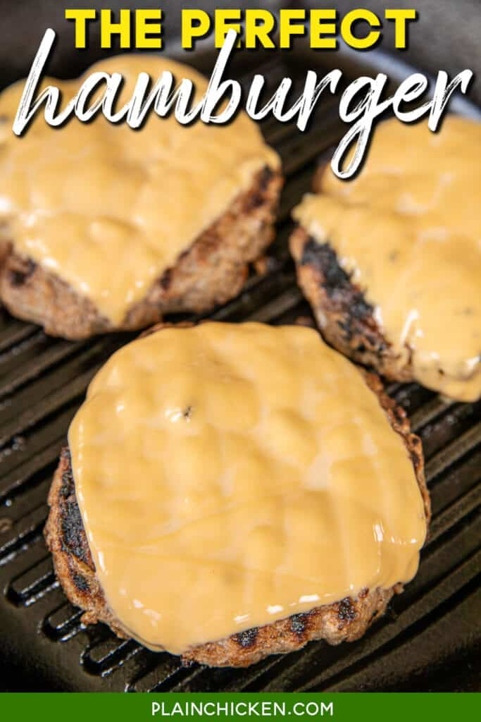 cheeseburgers cooking in a cast iron skillet