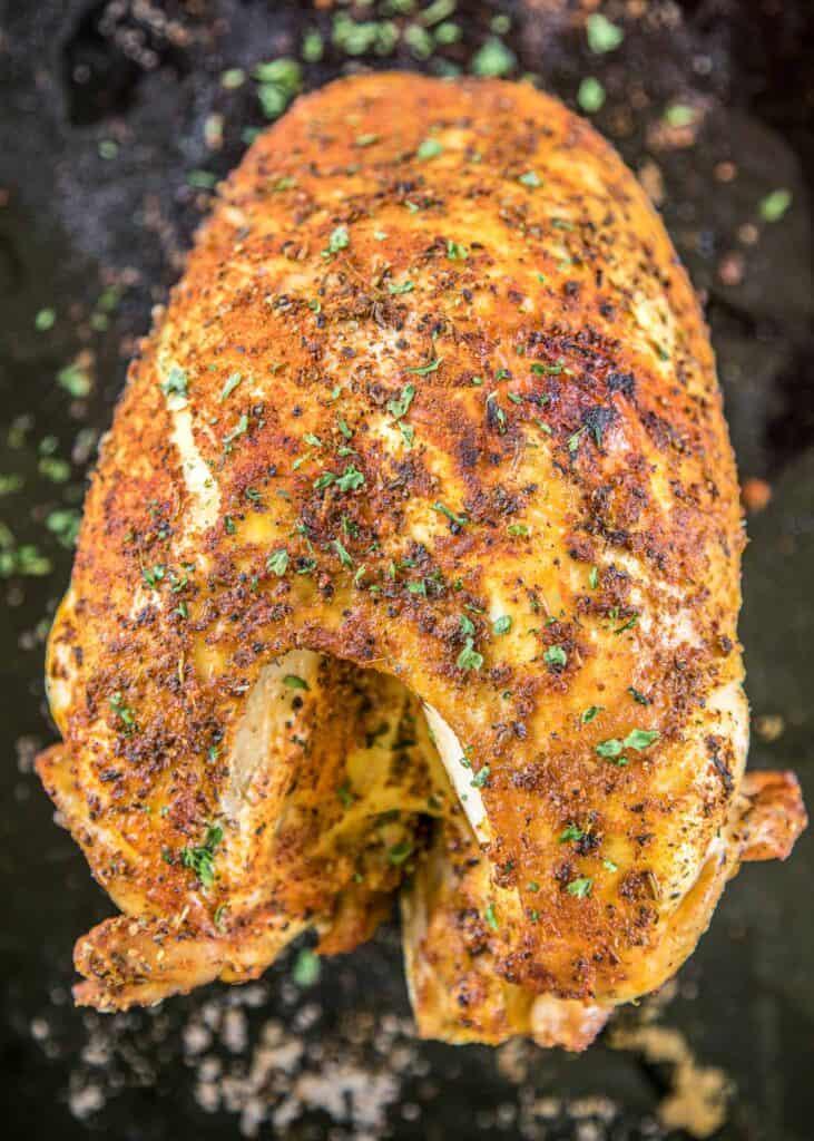 cooked bone-in turkey breast on a platter