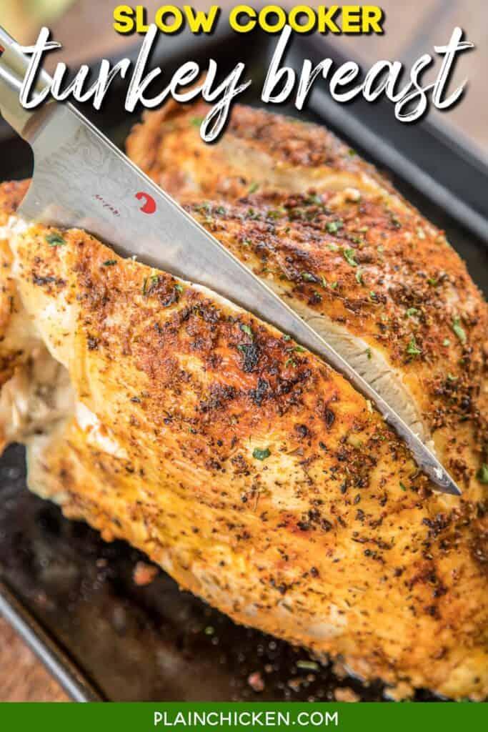 cutting into a whole turkey breast