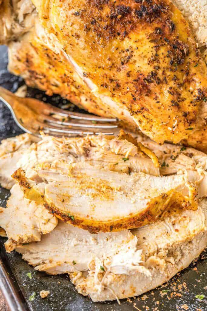 sliced turkey breast on a platter