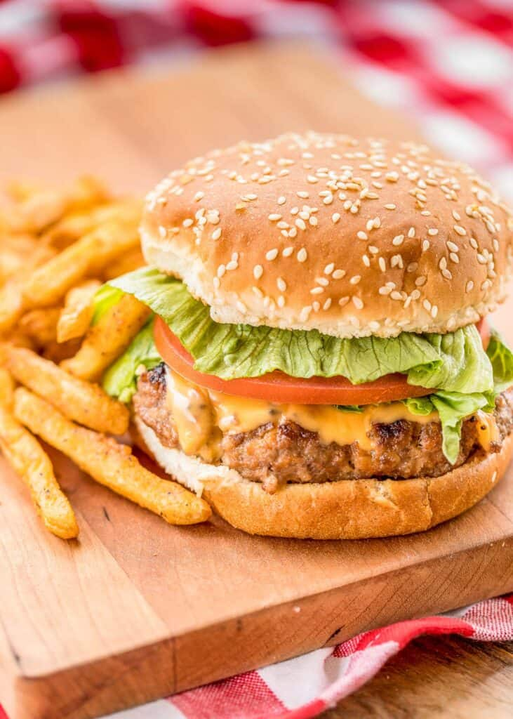 grilled meatloaf burger on a platter with fries