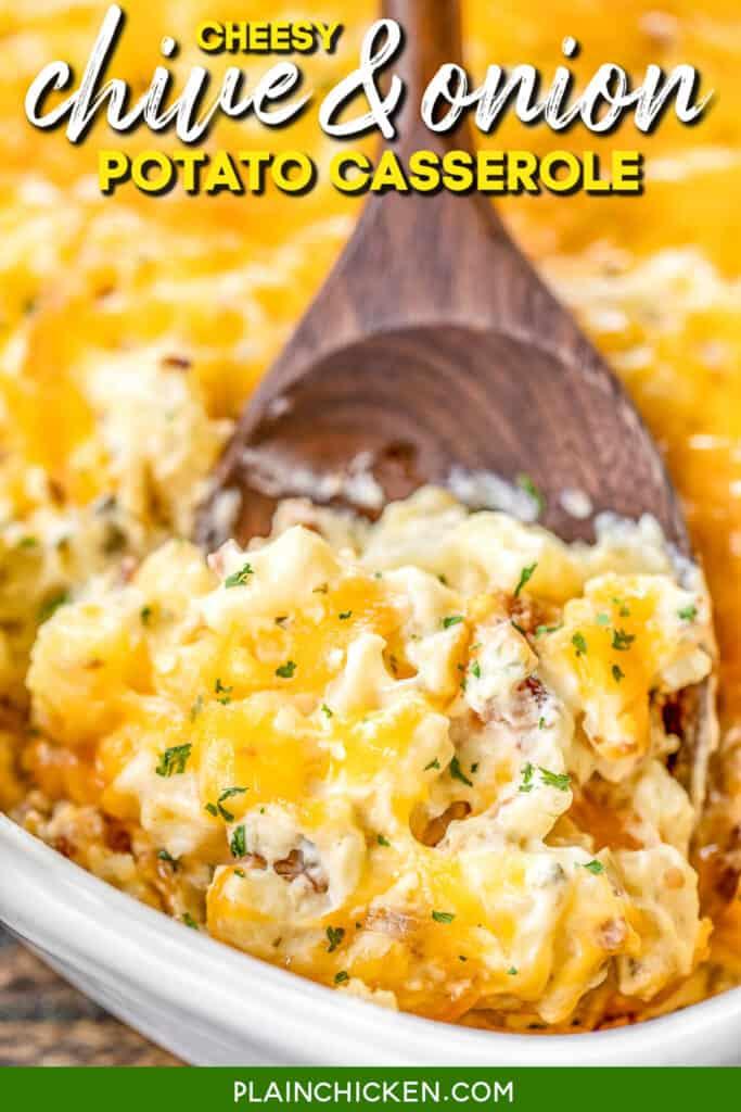 scooping cheesy potato casserole from baking dish