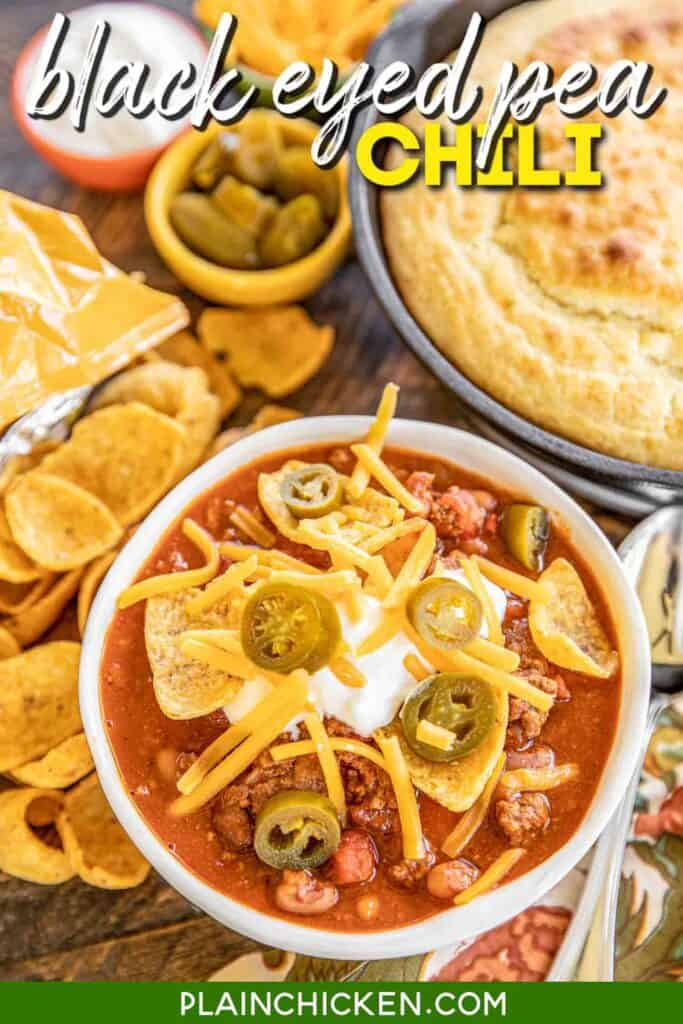 bowl of chili topped with cheese and jalapenos