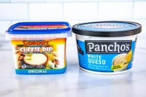 photo of two containers of mexican queso dip