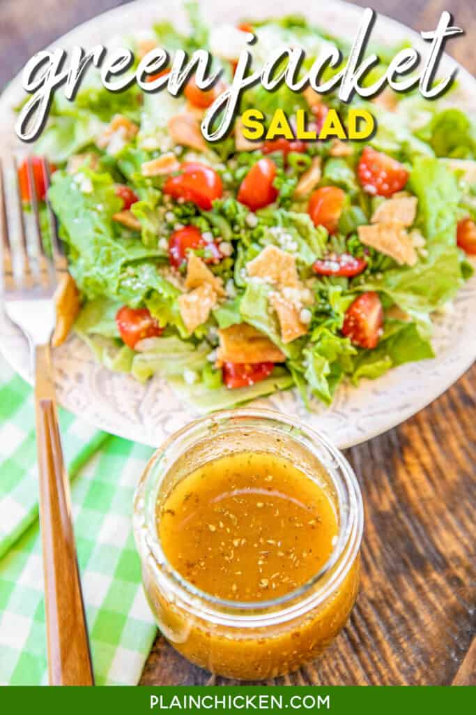 jar of salad dressing and plate of salad
