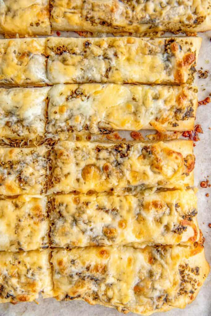baking sheet of cheesy breadsticks