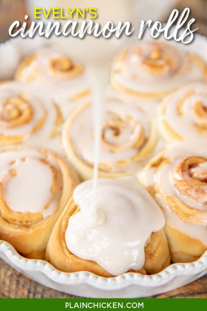 pouring frosting over cinnamon rolls