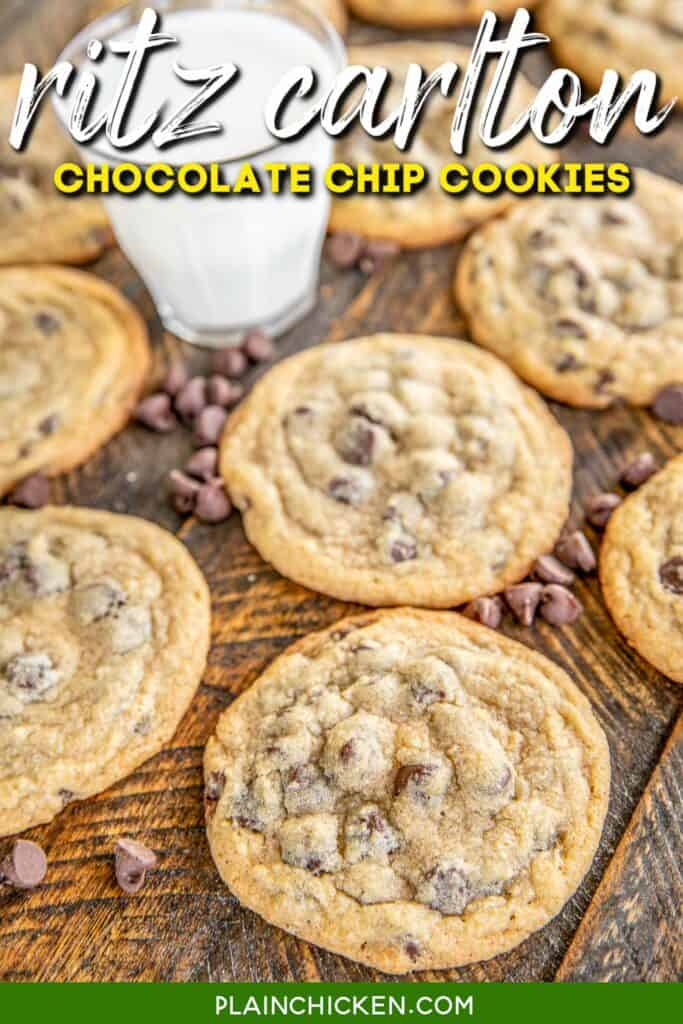 chocolate chip cookies on a board with milk