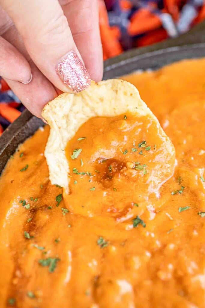 dipping chip in cheese dip