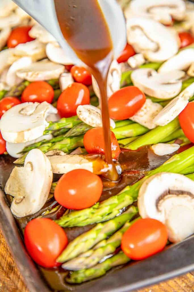 pouring balsamic over vegetables