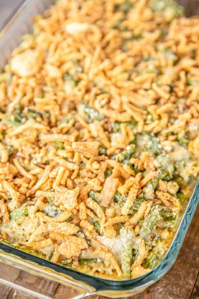 baking dish of green beans artichokes and fried onions