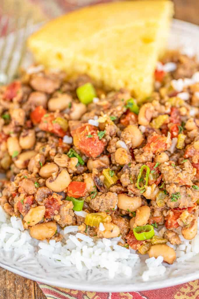 plate of black eyed peas and sausage over rice