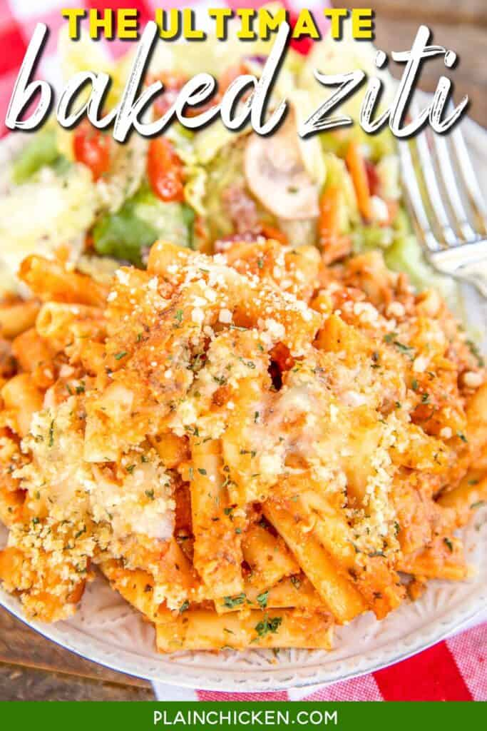 plate of baked ziti pasta with salad