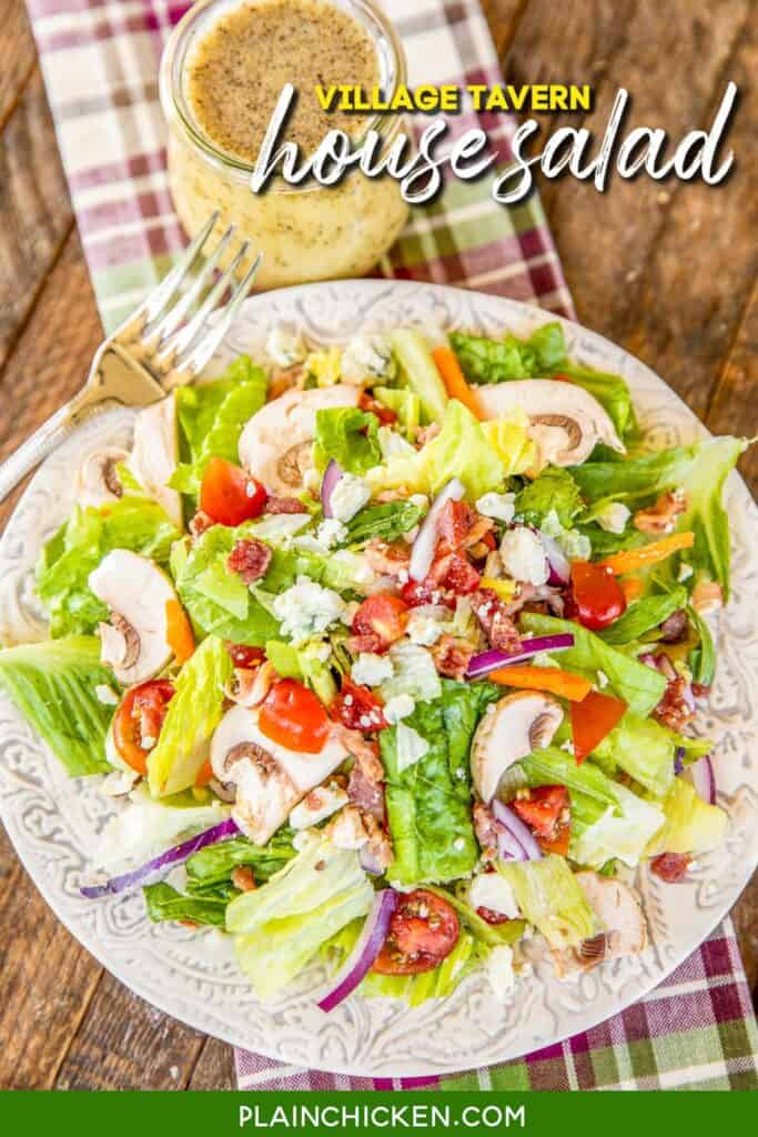 plate of salad with a jar of dressing