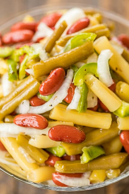 Three Bean Salad - so quick and delicious!! Green Beans, Yellow Wax Beans, Kidney Beans, Vidalia Onion, Green Bell Pepper tossed in sugar, cider vinegar, oil, salt and pepper. Make in advance in refrigerate until ready to serve. Great for potlucks and cookouts! #salad #sidedish #beans #nobake