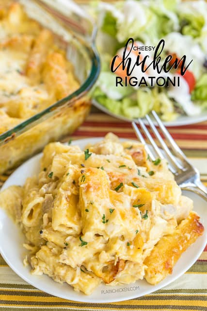 Cheesy Chicken Rigatoni - CRAZY good!!! The whole family cleaned their plates and went back for seconds! Such an easy weeknight casserole recipe! Can make ahead and refrigerate or freeze for later too! Chicken, rigatoni, cheese soup, evaporated milk, heavy cream, garlic mozzarella, cream of chicken soup and rigatoni. SO good! I wanted to face plant in the casserole dish!! LOL!
