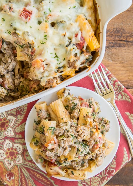 Cheesy Italian Sausage and Spinach Pasta Bake - pasta, onion, spinach, Italian sausage, tomatoes, italian seasoning, chive-and-onion cream cheese, garlic and mozzarella. This casserole was a HUGE hit!! Everyone cleaned their plate! Can make ahead of time and refrigerate until ready to bake. Great potluck meal!