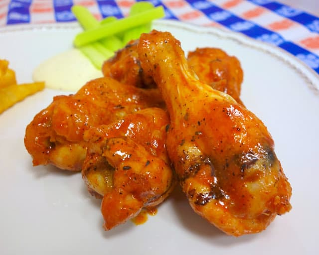 Dirty Steve's Famous Wings - seriously THE BEST wing sauce EVER!! We like to bake the chicken wings and toss in the sauce. You can fry the wings if you prefer. Make the sauce now and refrigerate up to 2 months! SO good!!! Perfect amount of heat! #wings #tailgating #hotsauce