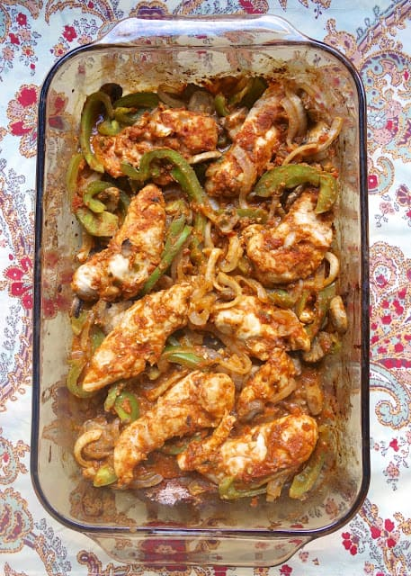 Oven Baked Chicken Fajitas - chicken tenders, onions, peppers and homemade fajita seasoning. Can use a seasoning packet instead of homemade. SO good! Ready in 20 minutes! We like them better than the Mexican restaurant!!