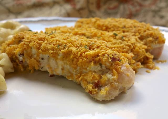 "Baked ""Crack Dip"" Chicken Tenders Recipe - chicken tenders topped with cheddar, bacon, ranch, Greek yogurt or sour cream and cornflakes. Ready in 20 minutes! Quick weeknight meal."