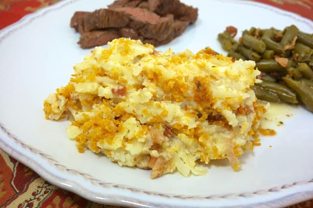 """""""Crack Potatoes"""" - potato casserole made with Greek yogurt, cheddar, bacon & ranch! SO good. People go crazy over these! I take these to potlucks and there are never any left!! Can make ahead and freeze."""
