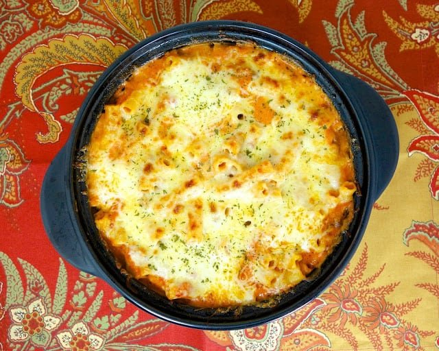 One-Pot Baked Ziti - everything cooks in the same pot, even the pasta!!! Italian sausage, onion, garlic, crushed tomatoes, water, ziti pasta, ricotta, heavy cream and mozzarella cheese - 100% from scratch pasta dish that is ready in under 30 minutes! Everyone (even the kids) LOVES this recipe!!