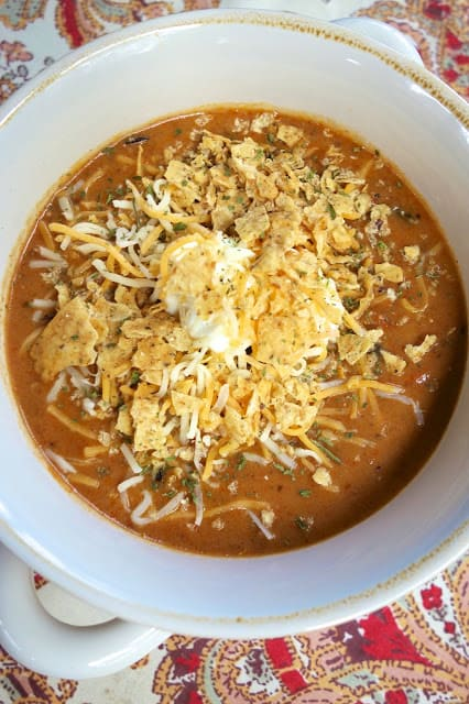 Beefy Nacho Soup - ready in 15 minutes!! Ground beef, taco seasoning, cheese soup, black bans, Rotel, milk - top with more cheese, tortilla chips and sour cream. This soup is ridiculously good! I love that it only takes about 15 minutes. Use mild Rotel if worried about the heat.