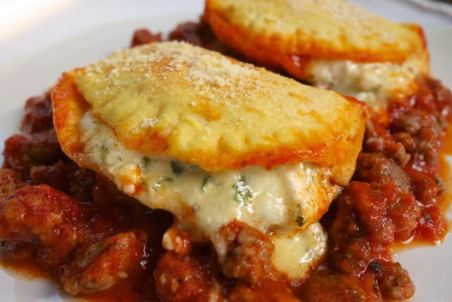 Cheesy Biscuit Lasagna - Biscuits stuffed with cheese and baked in a meat sauce - all the flavors of lasagna that is ready in under 30 minutes! Everyone LOVED this casserole! Fun twist to traditional lasagna.