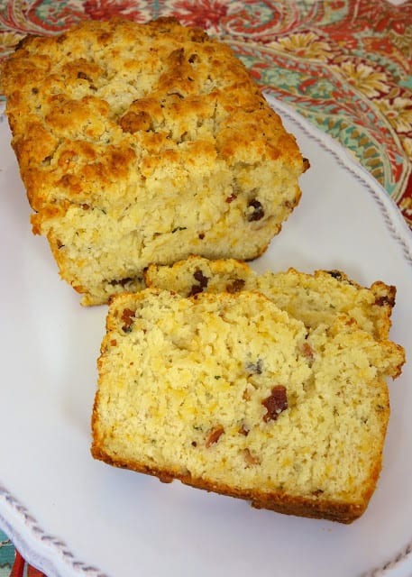 Cracked Out Beer Bread recipe - quick homemade beer bread that is loaded with cheddar, bacon and ranch. Ready to eat in under an hour!! Great with soups and stews!