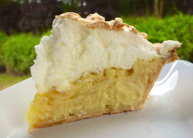 Coconut Meringue Pie - hands down the BEST coconut pie we've ever eaten! SO easy to make and it tastes amazing!!! Great for parties and and the holidays! Coconut, sugar, cornstarch, salt, milk, eggs, butter, corn syrup, vanilla, pie crust, cream of tarter. Can make the day before and refrigerate until serving. #pie #coconut
