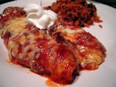 Weeknight Beef Enchiladas - beef, tomato soup, enchilada sauce, tortillas and cheese - make ahead of time and refrigerate or freeze. These are always a hit at our house! We never have any leftovers!! #mexican #casserole #freezermeal
