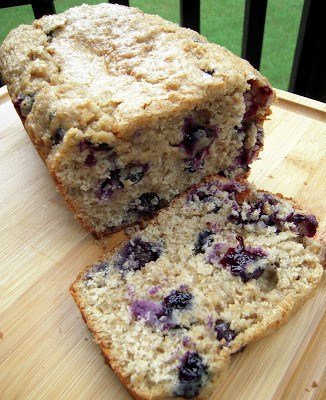 Quick Blueberry Bread - AMAZING!!! Quick homemade sweet bread with oatmeal and blueberries. Great for breakfast or dessert! Brown sugar, milk, oil, eggs, flour, oatmeal, baking powder, cinnamon, blueberries and raw sugar. We make this at least once a week! Great toasted with butter or with a big scoop of vanilla ice cream! #bread #blueberries #breakfast