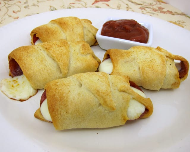 Crescent Pepperoni Roll-Ups - only 3 ingredients! Great for an after school snack or fun twist to pizza night! Serve with a side of hot pizza sauce.