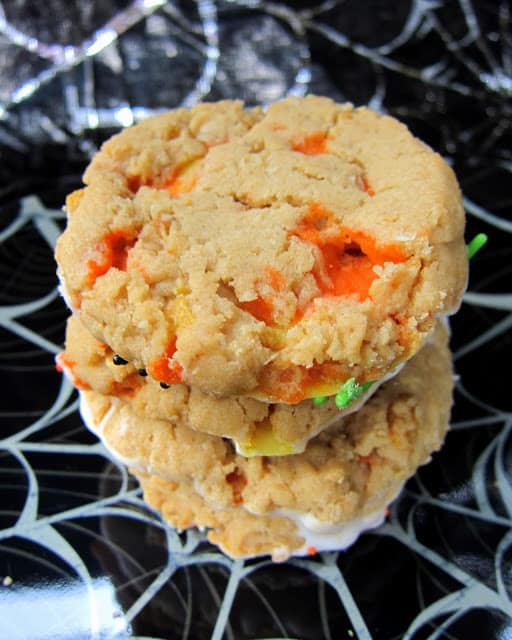 Peanut Butter Candy Corn Crunchies - peanut butter cookies with candy corn and corn flakes - dip in white chocolate and sprinkles to make extra festive!