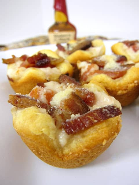 Kentucky Hot Brown Bites - turkey, bacon, tomatoes and mornay sauce baked in mini muffin pan - perfect for your Derby Day parties and leftover holiday turkey!