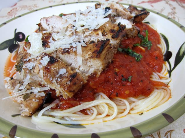 Tagliarini Picchi Pacchiu with Chicken - copycat recipe from Carrabba's Italian Restaurant. SO delicious!! Chicken marinated in balsamic vinegar, olive oil, garlic and basil and tossed in pasta with crushed tomatoes, garlic and basil. SO simple and SOOOO delicious!! Tastes better than the original! #chicken #pasta #carrabbas