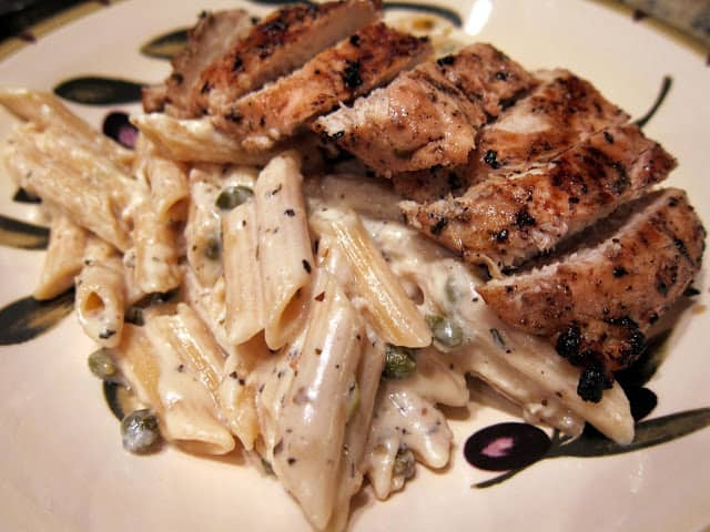 Creamy Grilled Chicken Piccata - grilled lemon herb chicken over a creamy piccata sauce. SO good! Better than any restaurant! We make this at least once a month!