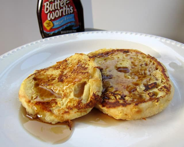 English Muffin French Toast - our FAVORITE french toast recipe! AND it is low-calorie!!! English muffins split and soaked overnight in a mixture of egg beaters, low-fat milk, and vanilla. Cook in a non-stick skillet and serve with sugar-free syrup. We LOVE this easy breakfast! Great for overnight guests or a quick weekday breakfast!