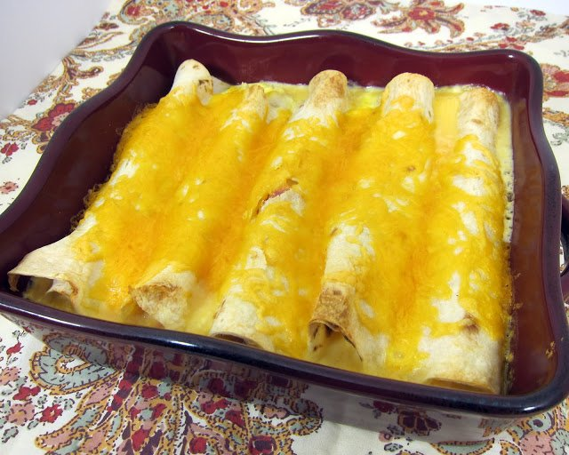 Quichiladas - Overnight Breakfast Enchiladas - stuff tortillas with your favorite meats and cheeses, pour egg mixture on top and refrigerate overnight.
